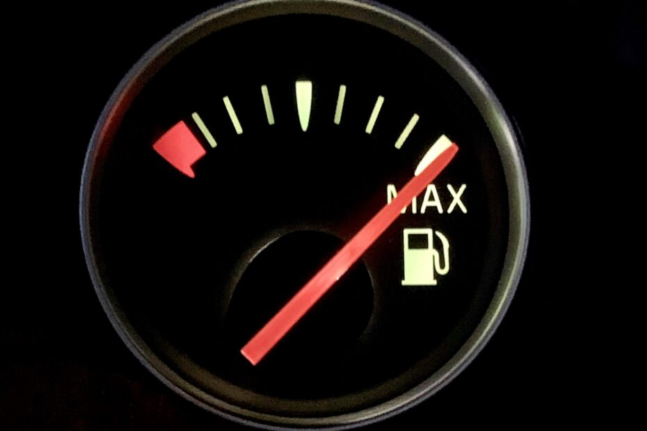 Closeup of car fuel gauge on max, full tank